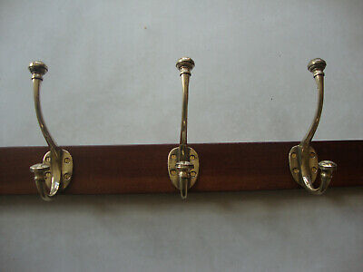 Antique very solid robust coat hooks on solid mahogany board