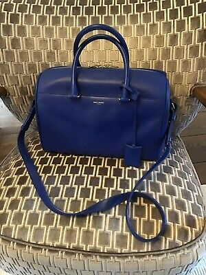 Beautiful Authentic Yves Saint Laurent duffle bag in electric blue leather