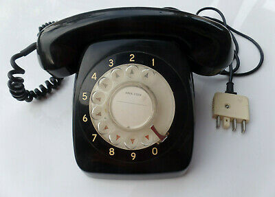 Vintage retro black Bakelite table top phone hand dial & gold numbers on face