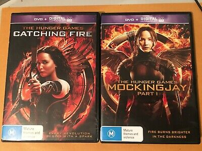 THE HUNGER GAMES - CATCHING FIRE + MOCKINGJAY PART 1 - DVD x 2 - R4 - VGC