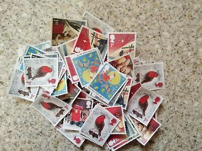 50 x UNFRANKED CHRISTMAS 1st CLASS STAMPS OFF PAPER NO GUM