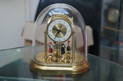 Vintage Ranela domed clock with rotating figures.