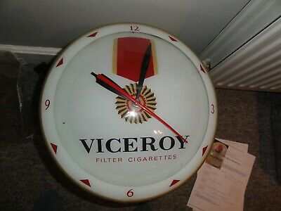Electric wall mounted, illuminated advertising clock, in good working condition