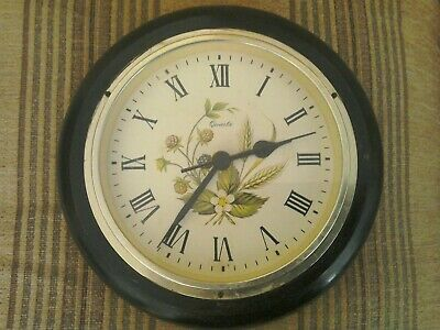 Vintage wall clock with wooden casing and Blackberries on face.