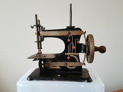 "ANTIQUE early SEWING MACHINE CHILD TOY TIN HAND CRANK 4 1/2"" tall"