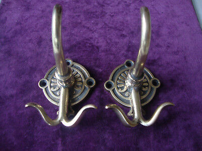 Super matched pair of fabulous quality brass coat hooks