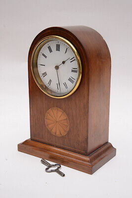 Edwardian mahogany inlaid mantel clock with Spanish naval history connection.
