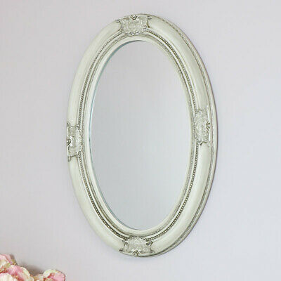 Antique white ornate oval wall mirror vintage French chic living room hallway