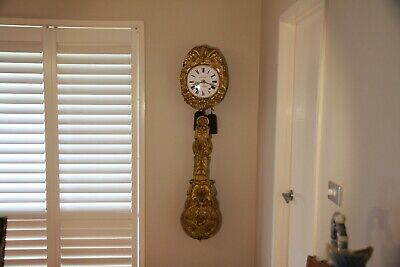 French Antique Comtoise Wall Clock with Repousse Brass Pendulum circa 1800's