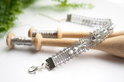 Bobbin lace pattern with therad bracelet begginers jewellery lacemaking