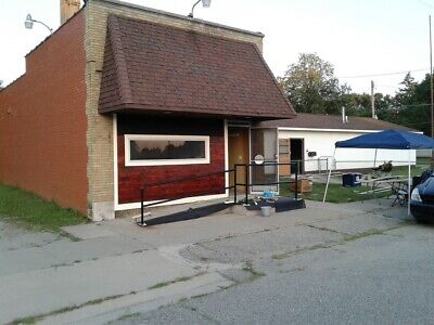4 houses, includes Commercial properties, Salon, Warehouse and large lot.