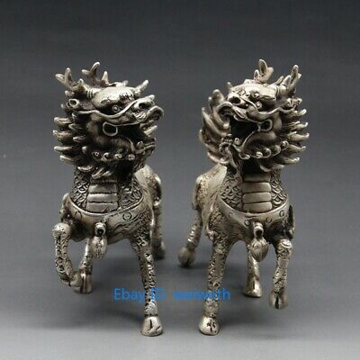 A pair Asian Chinese Tibet Silver Hand Carved Dragon Beast Kirin Statues
