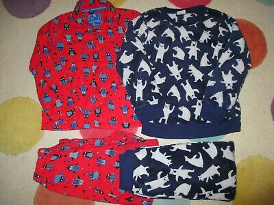 2 pairs of snuggly unisex children's winter PJ's age 6-7 years