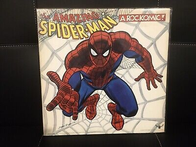 the AMAZING Spiderman Rare find with POSTER!!! Rock and Roll Comic Adventure