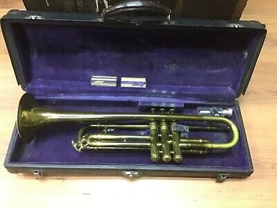 Boosey and Hawkes B&H Trumpet with mouthpiece and case with music scores