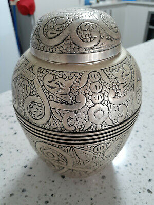 Ashes Urn for Adult never been used, Brass and silver embossed. 17.3H 12.2W