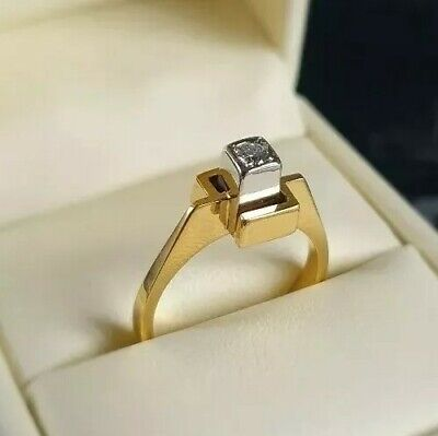 1970s MODERNIST 18ct yellow and white gold solitaire diamond ring