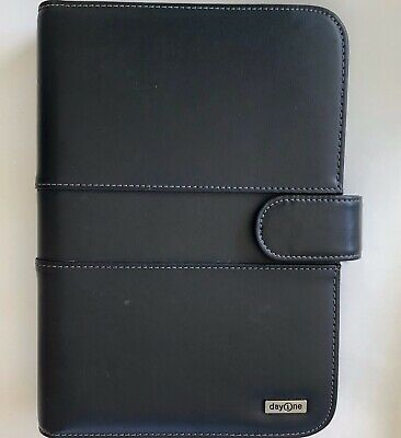 "Franklin Covey Day One 7 Ring Planner Black 7"" X10"" Binder with some Inserts."