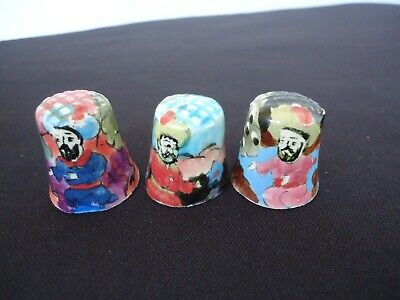 3 hand painted made pottery thimbles