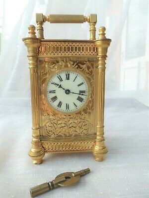 Beautiful French Carriage Clock, Gilt Filigree Front. Eight Day.Enamel Dial,