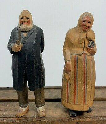 Antique Pair Carved Wood Folk Art Dressed Man Pipe Woman Bible