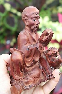Chinese carved rosewood Luohan/Archat with a tiger, Qing dynasty