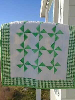 Green, white, hand made, hand quilted baby quilt