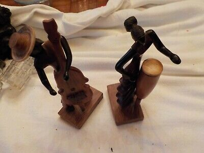 Two Hand Carved Figures Playing Instruments