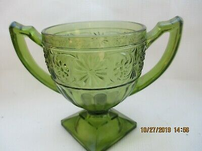 Green depression glass, footed with two handles, possibly a sugar bowl