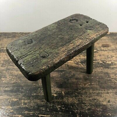 A fantastic 18th century European primitive milking stool with original paint