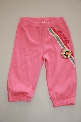 Girls pink elasticated track suit bottoms - age 4 to 5 years