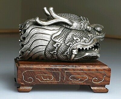 A late Qing Dynasty Chinese Silver Dragons Head.