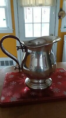 Silver Pitcher With Leather Handle