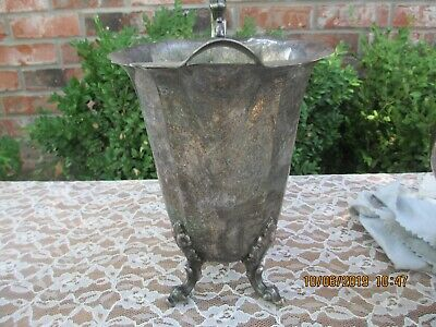 Footed silverplate water pitcher 8 3/8'' tall handle height  is 10 7/8'' tall