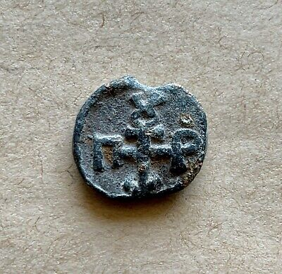 Early byzantine lead seal/bleisiegel with cruciform monogram in either side (2)