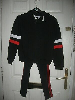 Black with red & white striped complete track suit from primark age 10/11 year's