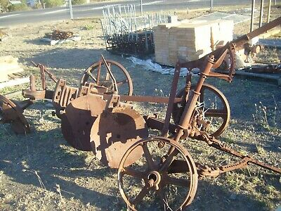 a very old double disc plough a great garden feature hard to find these days
