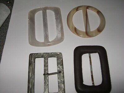 3 bakelite and one leather covered buckles