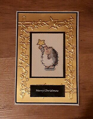 Completed Cross Stitch Christmas Card - Hedgehog holding a star.