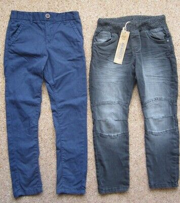 2 pair F&F Boys trousers age 6-7 years, one black NEW with tags, one navy blue