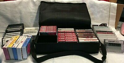 collection of cassette tapes with carrying case that holds 30 cassettes