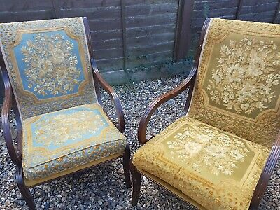 Vintage arm chairs in need of refurbishment.