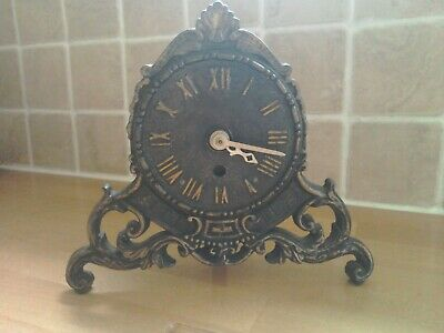Antique cast iron mantle clock.