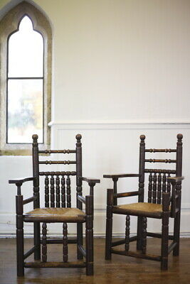 Pair of Arts and Crafts armchairs with rush seats