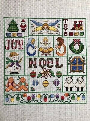 Completed finished cross stitch Christmas sampler