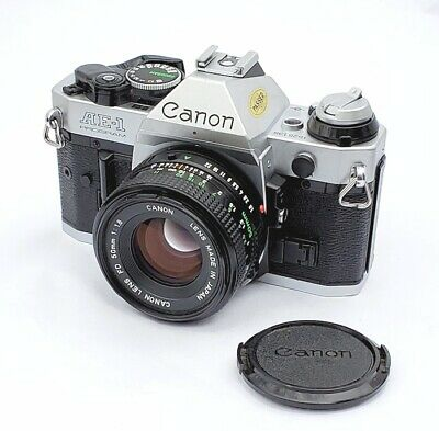 Beautiful Canon AE-1 Program Camera with a 50mm f1.8 Lens,  EX++  with Warranty