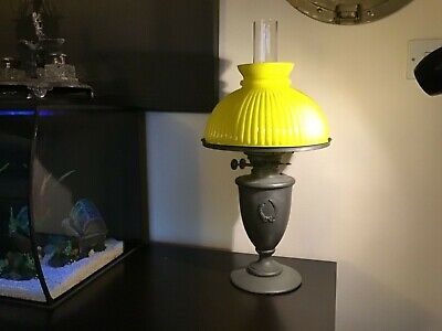 Antique vintage oil lamp with yellow glass shade