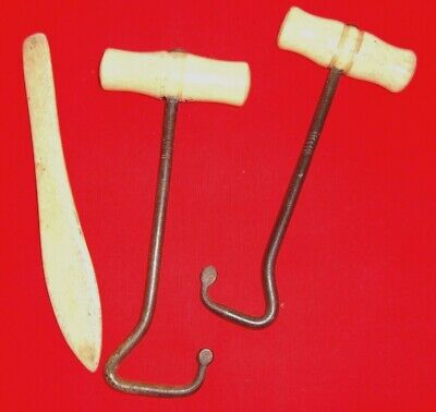 A pair of antique military/hunting bone boot pulls and matching bone shoe horn