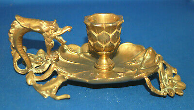 An Art Nouveau floral, dragon, gryphon handle chamber candlestick, antique gilt