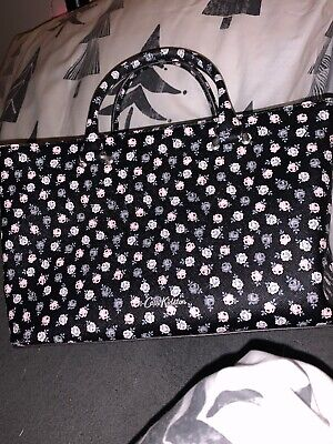 CATH KIDSTON BLACK AND FLORAL SMALL BAG *Long Strap Needs To Be Stitched *